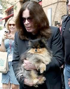 osbourne pomeranian ozzy osbourne carries pet pooch as he leaves hotel in new york daily mail