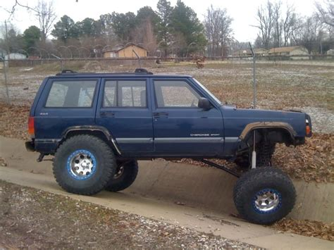 jeep lifted blue 2000 xj patriot blue 8 quot iro lift 35 s jeep cherokee forum