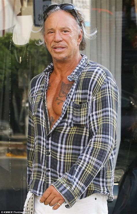 mickey rourke tattoos mickey rourke leaves his shirt unbuttoned his