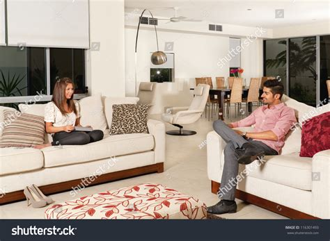 young couple room young couple relaxing modern living room stock photo