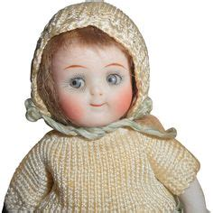 jointed doll knee character faced and googly antique vintage dolls on