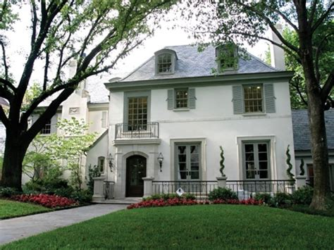 french chateau style home in stucco cast stone stucco house colors french stucco home with shutters