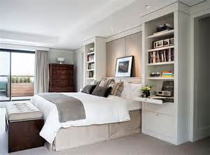 built in bedroom storage i like the built in bookcases night tables that frame the bed interesting idea design ideas