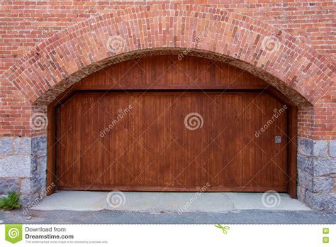 large wooden garage door  arch stock image image