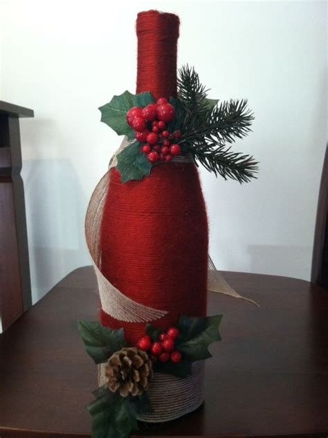 this one is a wine bottle wrapped in yarn with some