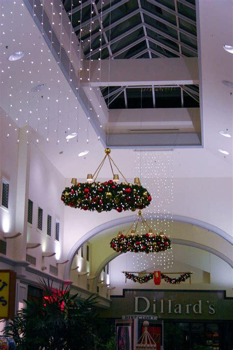 christmas wreaths adorn  ceiling   information  center stage seasonal decor visit