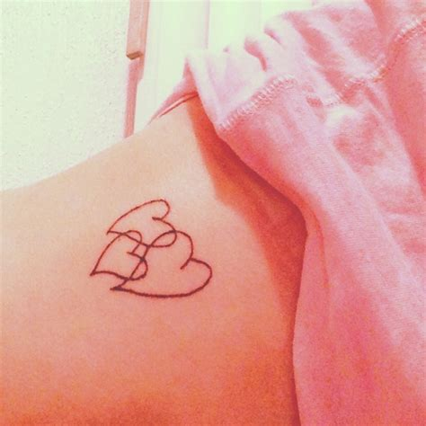 family heart tattoos with our names written in the lines of the hearts