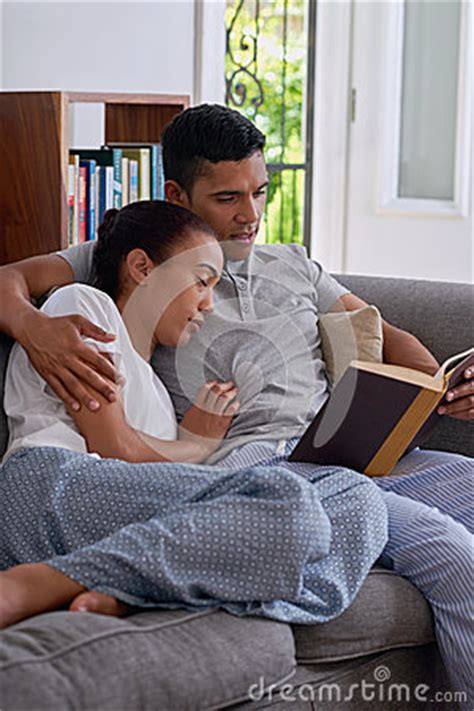 my husband sleeps on the couch husband read wife sleep stock photo image 53266963