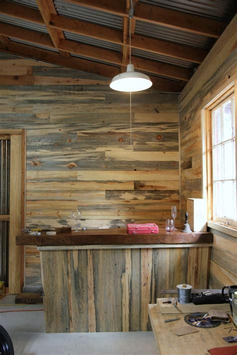 diy pipe shelf reclaimed wood plank walls
