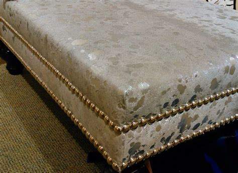 Metallic Cowhide Covered Ottoman Hides Pinterest Cowhide Cocktail Ottoman