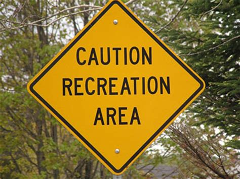 the color of a recreation area sign is pin warning sign with a ox on