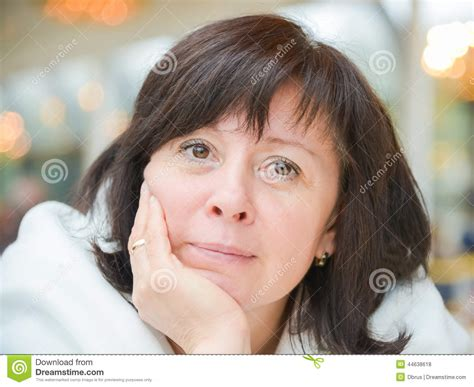 middle age women with blue hair middle aged woman brown eyes is sitting in the apartment