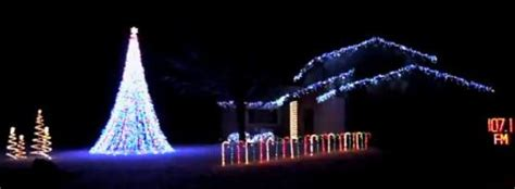 coon family christmas lights synchronized display in