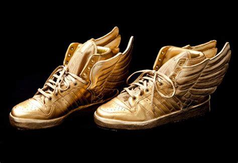 justin bieber s custom gold adidas wings sneakernews