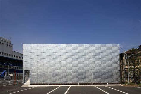 edogawa garage club receives a modern woven shade screen