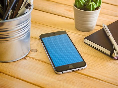 iphone on desk mockup mockupworld