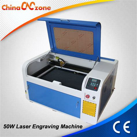 rubber st machine price list high precision 50w co2 rubber st laser engraving