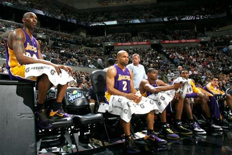 kobe bryant bench kobe bryant sits on a table next to the laker bench in