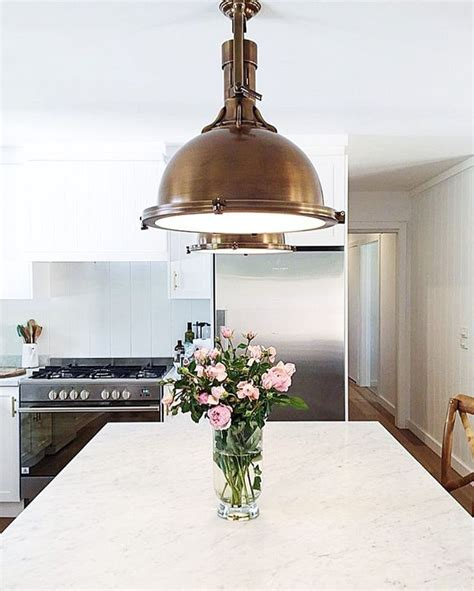 restoration hardware pendant lights modern farmhouse kitchen with carrara marble counters and
