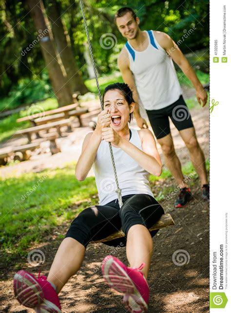 young swinging couple swinging on seesaw stock photo image 41322685