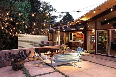 how to string lights across backyard bring on the night with beautiful patio lighting