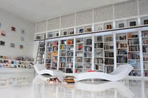 modern home library interior design view in home office modern white shelving and themes