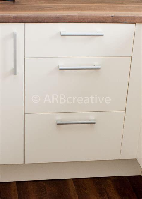 Gloss white slab kitchen