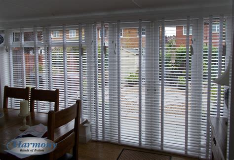White Wooden Blinds With Tapes Covering Patio Doors Wood Blinds For Patio Doors