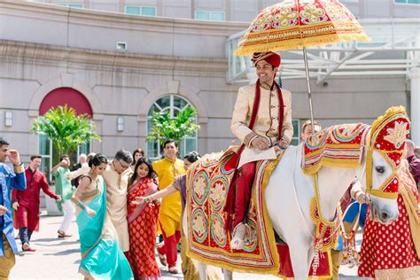 Indian Groom Makes Dramatic Entrance by A Vibrant Indian Fusion Wedding Kate Aspen