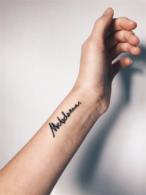 cursive wrist tattoo melodrama lorde wrist inspo script tat