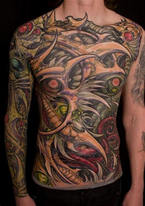 biomechanical chest side belly sleeve tattoo by analog tattoo
