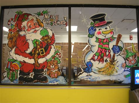 window painting signs christmas holiday seasonal artist seasonal window art drawing attention
