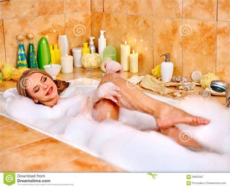 bathtube girl woman wash leg in bathtube stock photo image 56663307