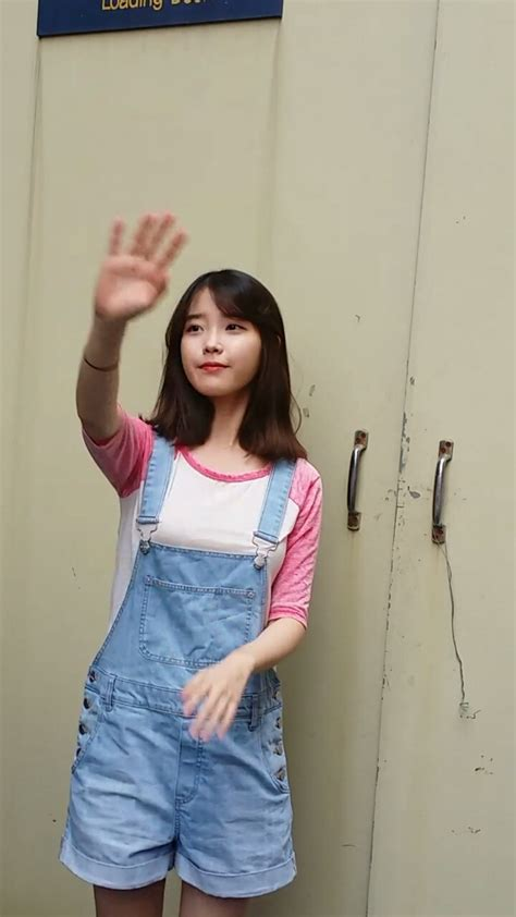 Overal Koreapink iu wears a pink baseball tshirt and denim overalls