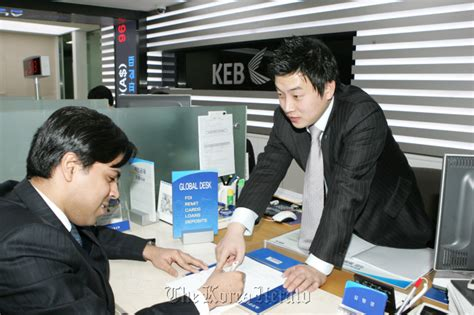 bank clerk local banks woo foreign customers
