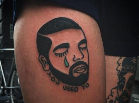 drake tattoo on forehead