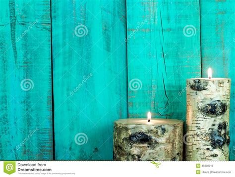 textured log candles burning  antique teal blue wooden