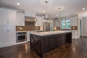 white and brown kitchen features white shaker cabinets
