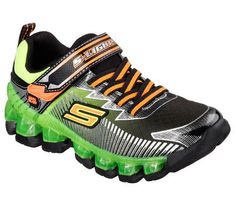 skechers light up shoes on off switch skechers boy s flashpod scoria black green orange light up