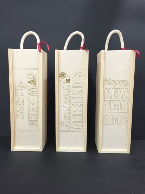 personalised laser etched christmas wine boxes  shindigg notonthehighstreetcom