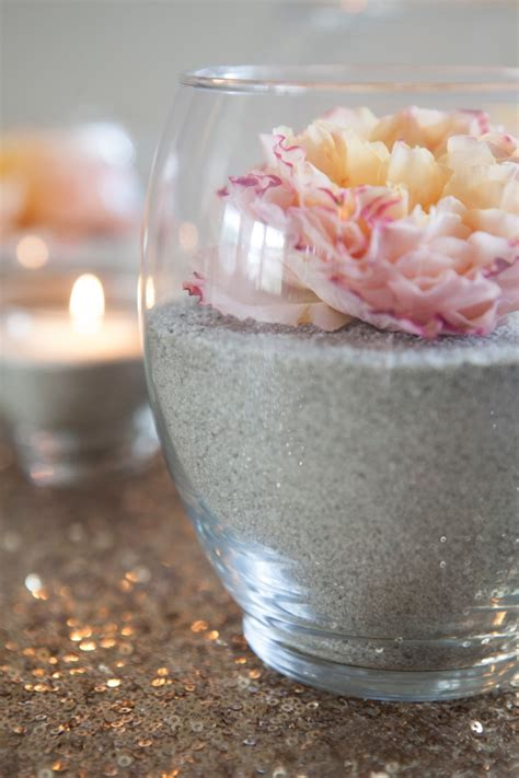 wedding centerpieces with candles and sand make these gorgeous sand and flower centerpieces
