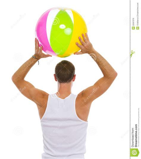 Man Throwing Beach Ball Rear View Stock Photo Image