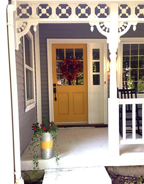farmhouse porch dovetail gray exterior  mustard door