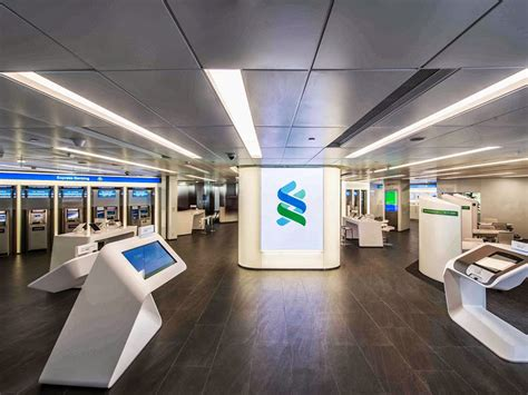 standard bank office contact details standard chartered announces pkr 12 1 billion profit
