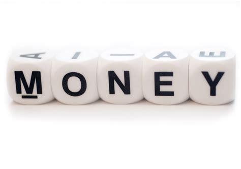 4 Bilder 1 Wort Auto Auf Geld by Free Word Money On The Dices Stock Photo Freeimages
