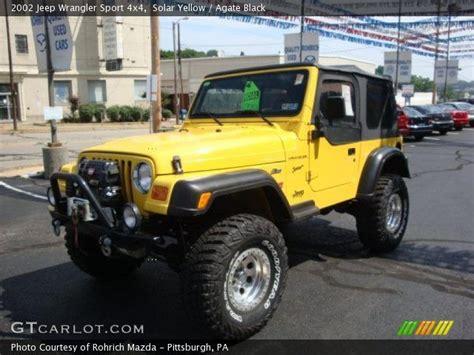 yellow jeep interior solar yellow 2002 jeep wrangler sport 4x4 with agate black