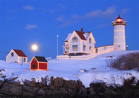 nubble lighthouse full moon and holiday lights by john burk