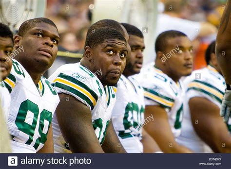 players on the bench green bay packers football players sitting on the bench