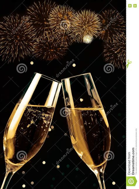 cheers happy new year chagne flutes with golden bubbles make cheers with