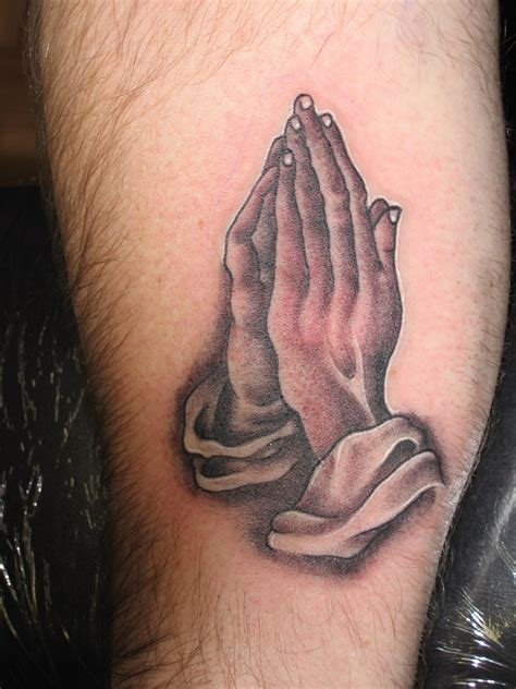 hand and cross tattoo praying tattoos designs ideas and meaning tattoos